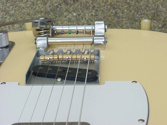 bigsby vibrato tailpiece pros and cons i personally don t like the way that particular bridge looks filed so when i make my dream tele i will have a bridge custom made holes coming though